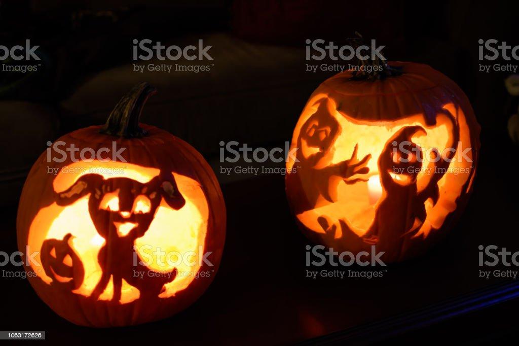 Spooky night Halloween Jack o'lanterns at home stock photo