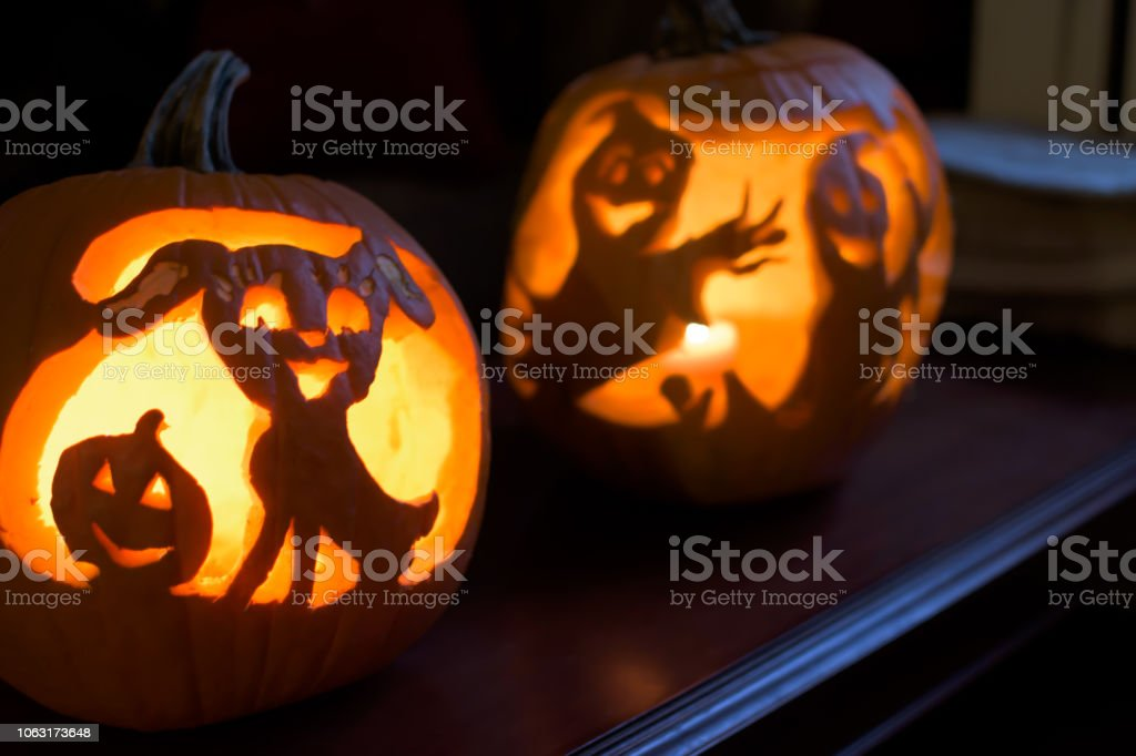 Spooky night Halloween Jack o'lanterns at home stock photo