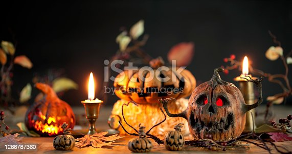 Spooky Pumpkin Jack O' Lantern Background on Wood