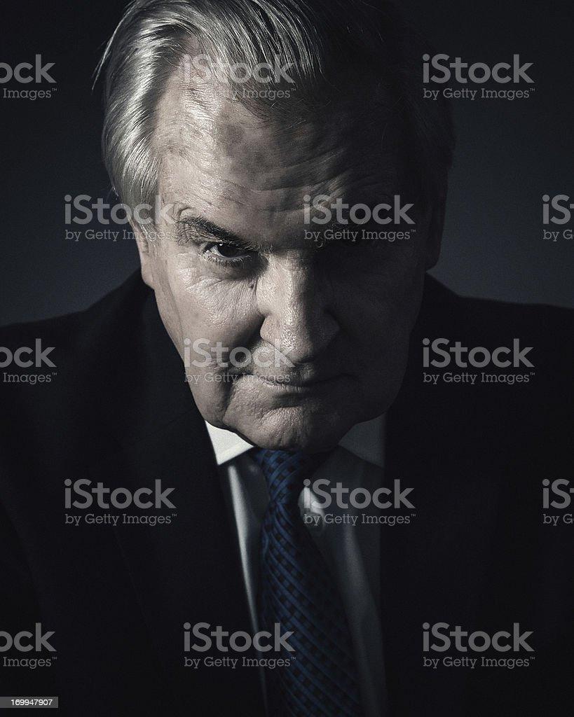 spooky senior businessman royalty-free stock photo