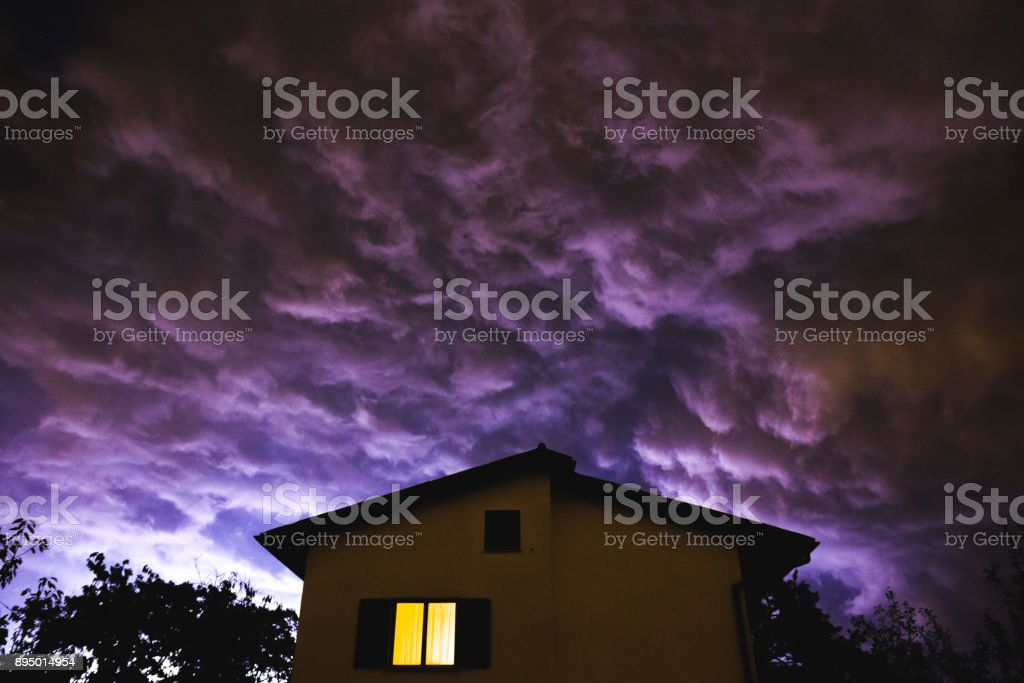 Spooky storm clouds over the house stock photo