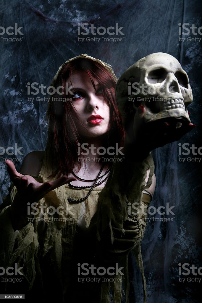 Spooky Young Woman Holding Skull royalty-free stock photo