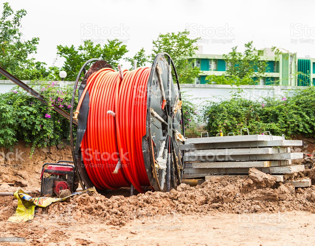 spool of cable and fiber optics in the road. stock photo