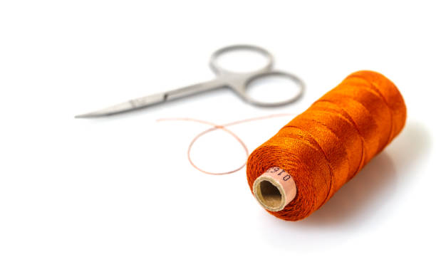spool of thread and scissors spool of thread and scissors on white isolated background spool stock pictures, royalty-free photos & images