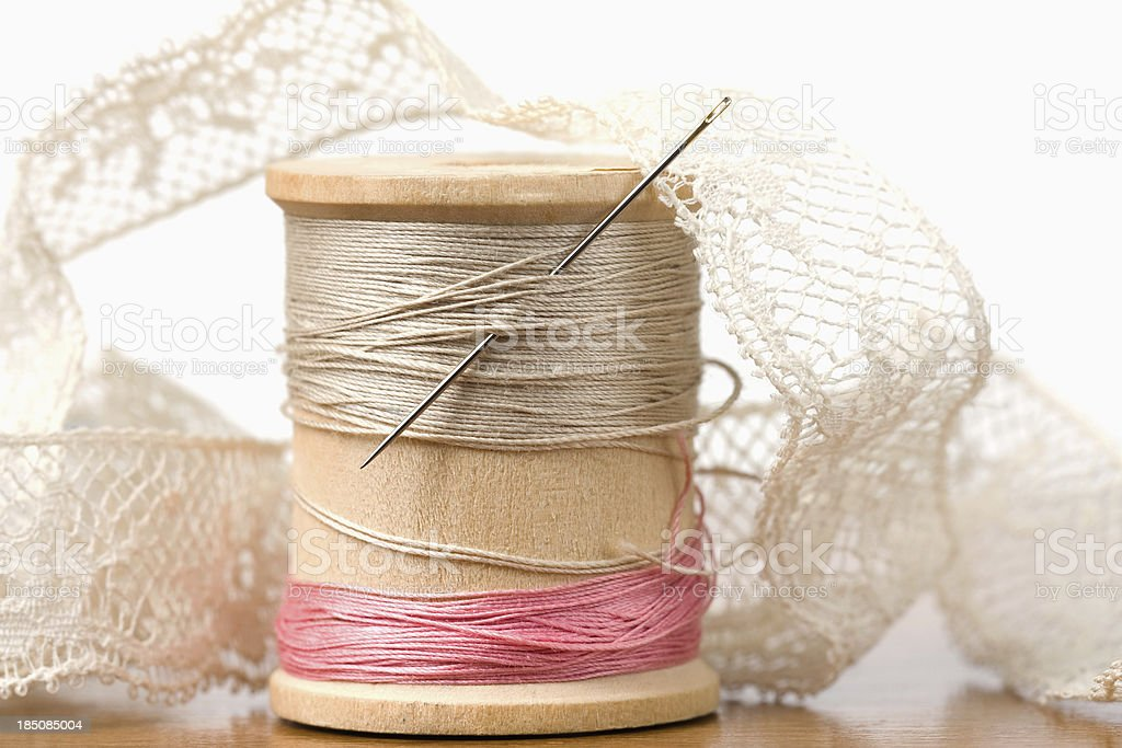 Spool of Thread with Needle and Lace royalty-free stock photo