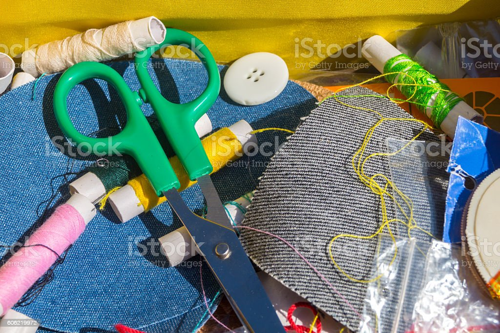 Spool of thread with needles and clippers on white background stock photo