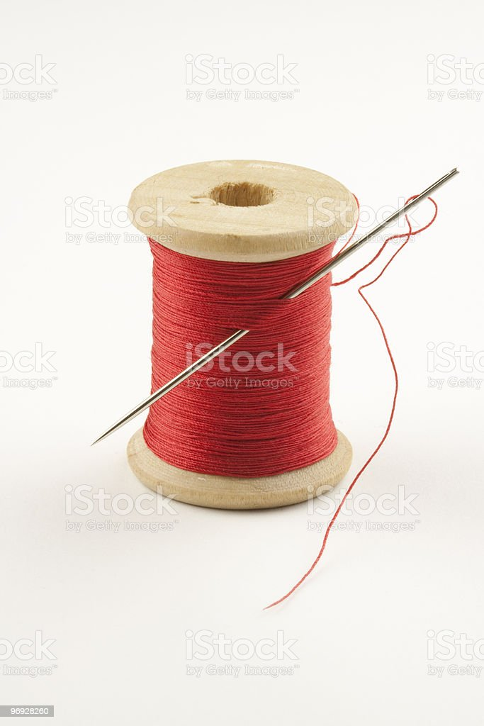 Spool with Thread and Needle royalty-free stock photo