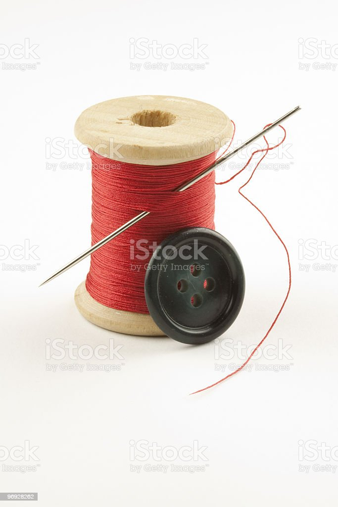 Spool with Thread, Button and Needle royalty-free stock photo