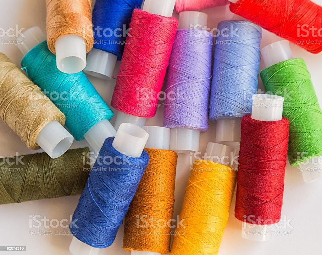 Spools of colorful thread stock photo