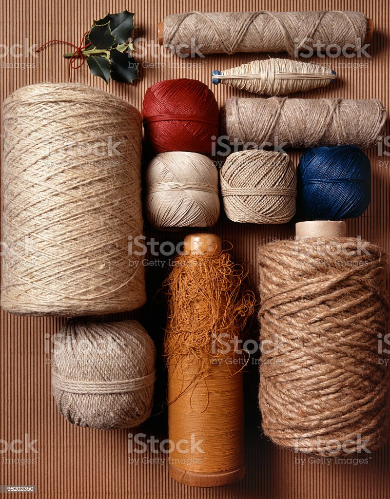 Spools of natural cotton and strings, different sizes and colours royalty-free stock photo