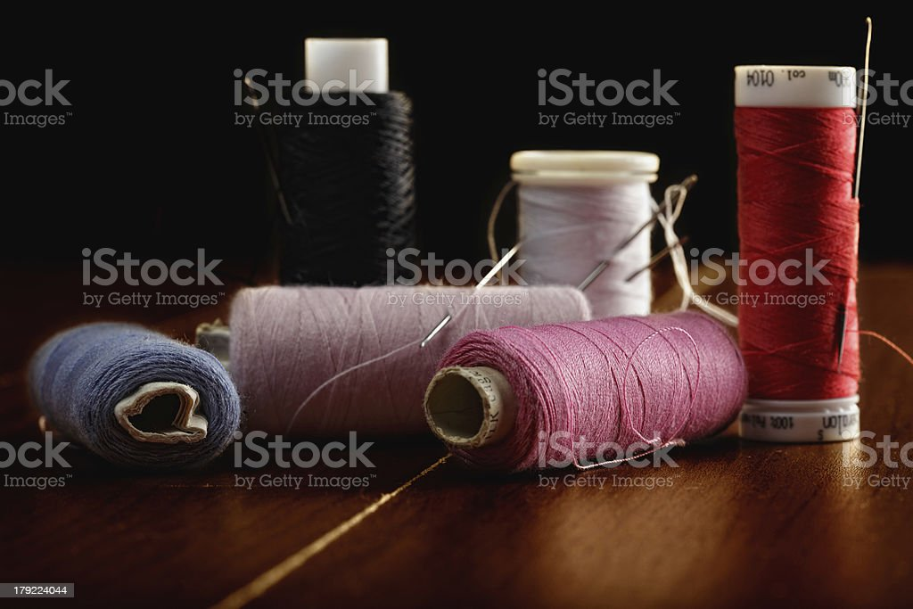 Spools of thread against dark royalty-free stock photo