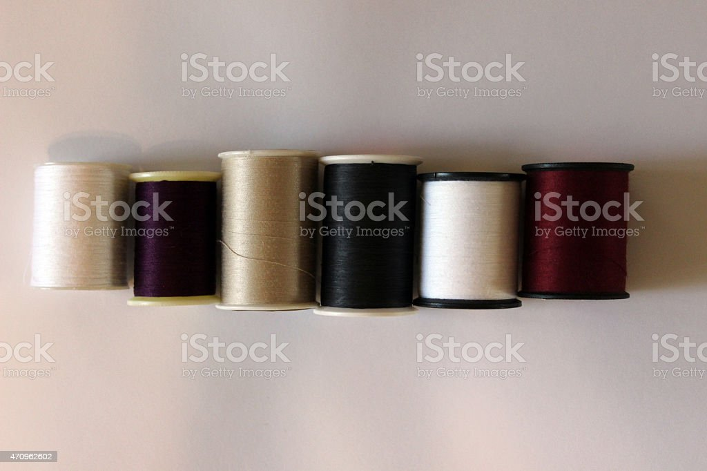 Spools of Thread Lined Up stock photo
