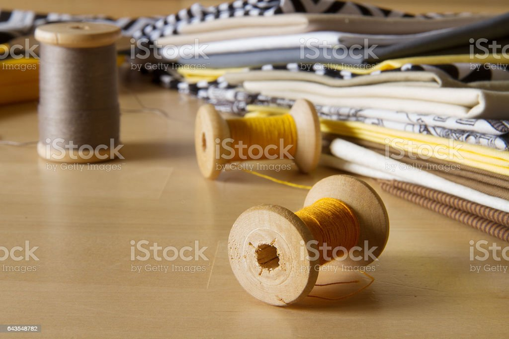 Spools with cotton fabrics in modern style стоковое фото