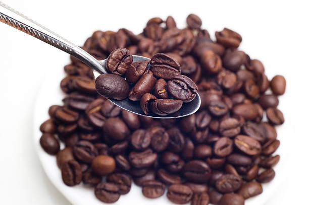 Spoon and coffee beans stock photo