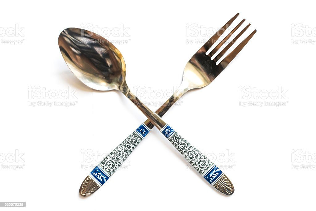 Spoon and fork are cross on white background. stock photo