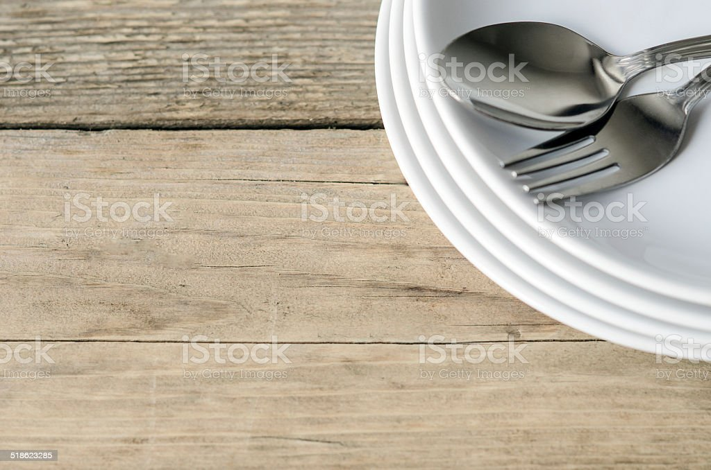 spoon and fork on a plate stock photo