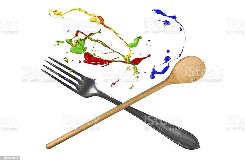 Spoon and fork with paint above royalty-free stock photo