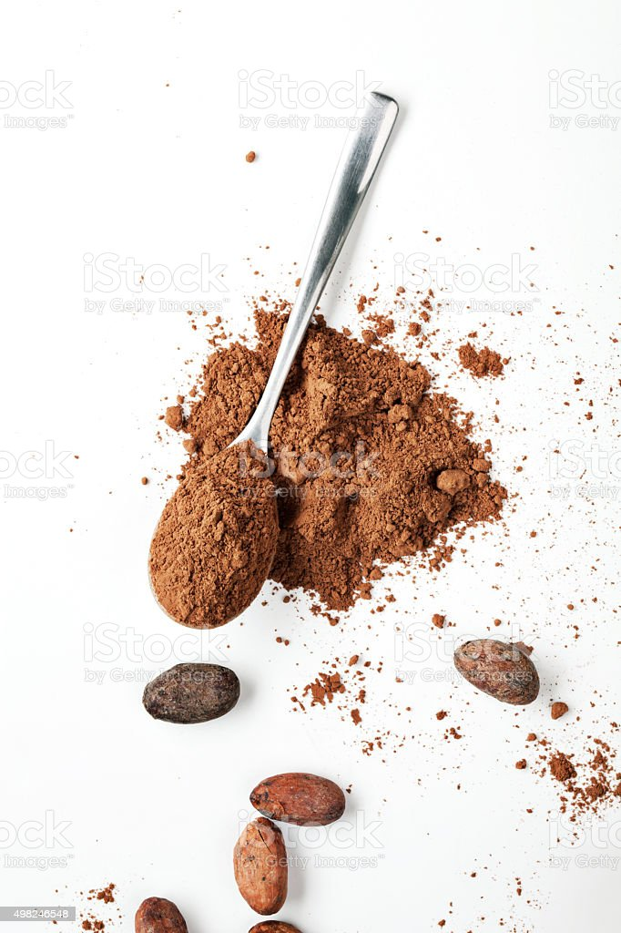 Spoon Cocoa Powder and Cocoa Beans stock photo