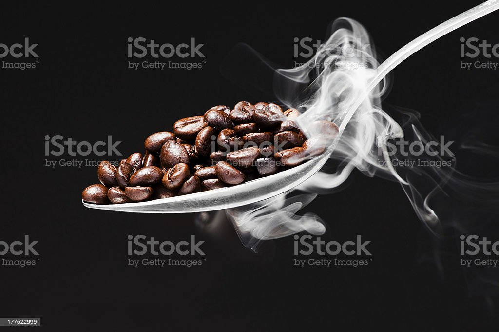 spoon coffee on black background with smoke royalty-free stock photo