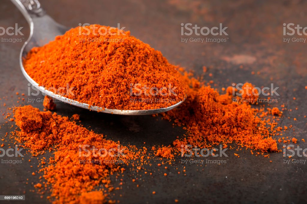 Spoon filled with paprika powder stock photo