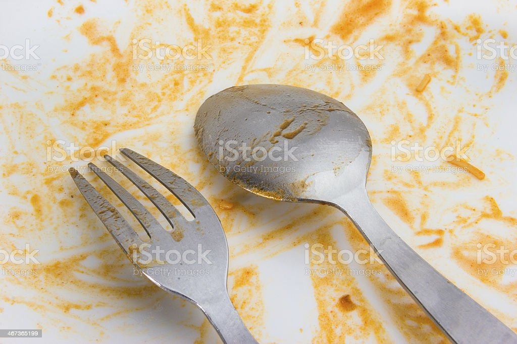 spoon fork after food on white background stock photo