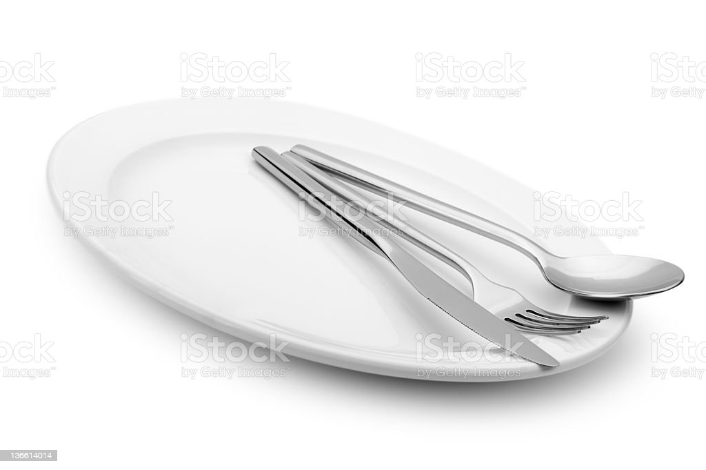 Spoon, fork and a knife lie on  plate royalty-free stock photo