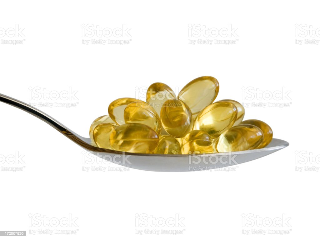 A spoon full of omega-3 fatty acid pills royalty-free stock photo