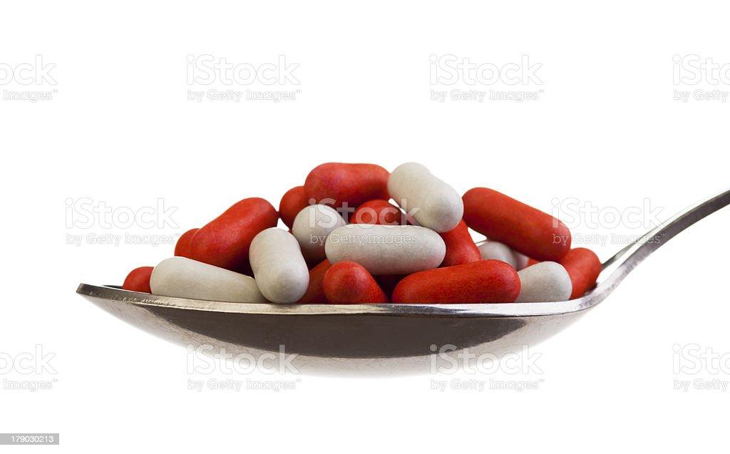 Spoon full of pills royalty-free stock photo