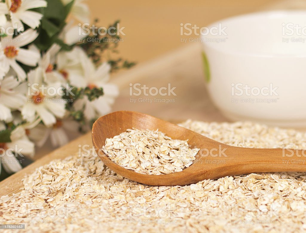 Spoon full of raw rolled oats royalty-free stock photo