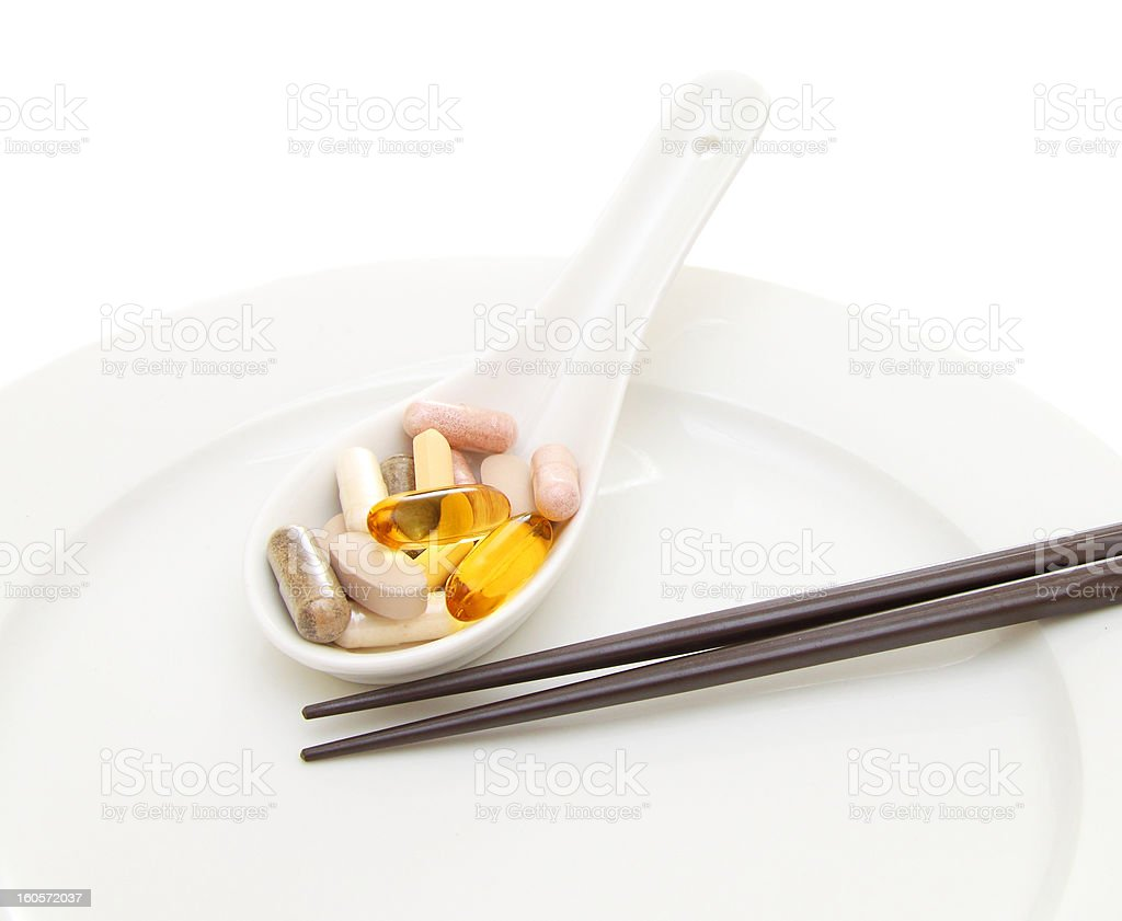 Spoon full of supplements royalty-free stock photo