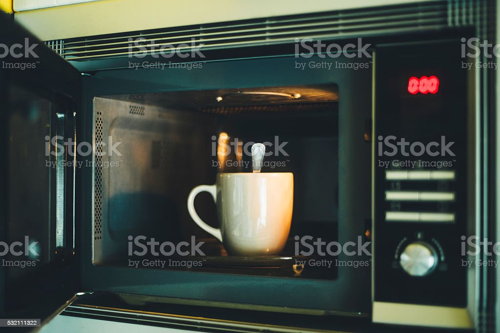 Spoon in the microwaves stock photo
