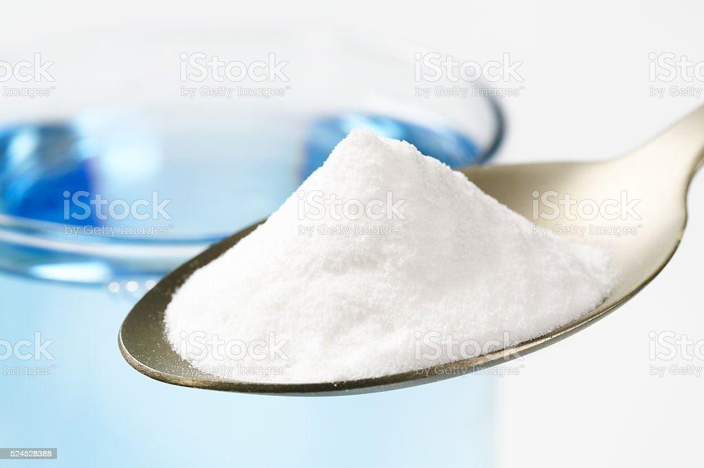 spoon of baking soda stock photo