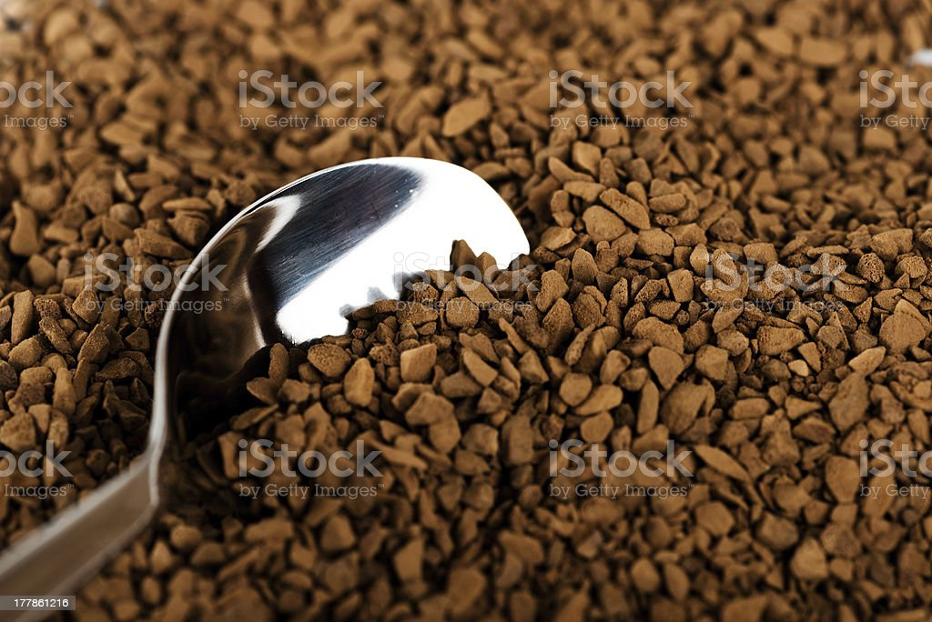Spoon of coffee at coffe background stock photo