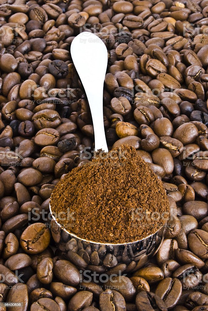 spoon of coffee on a background grains royalty-free stock photo