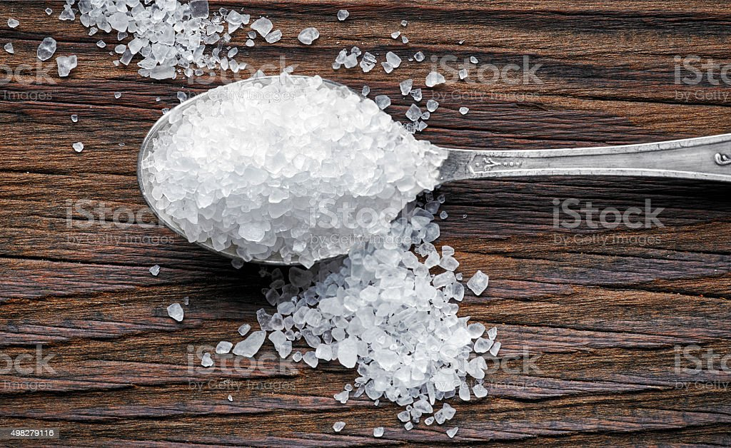 spoon of sea salt stock photo