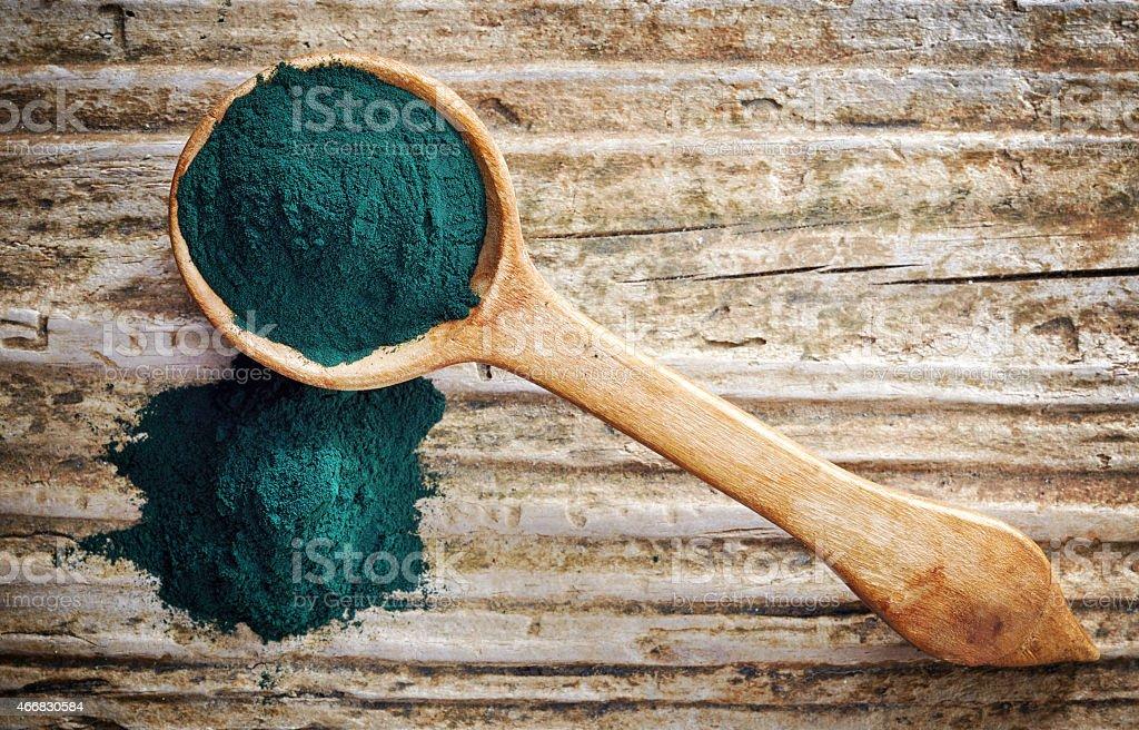 spoon of spirulina algae powder stock photo
