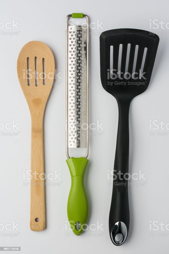Spoon Spatula Zester on White Background Top View stock photo