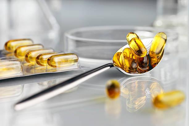 spoon vitamins pills omega 3 supplements with blister - vitamin d stok fotoğraflar ve resimler