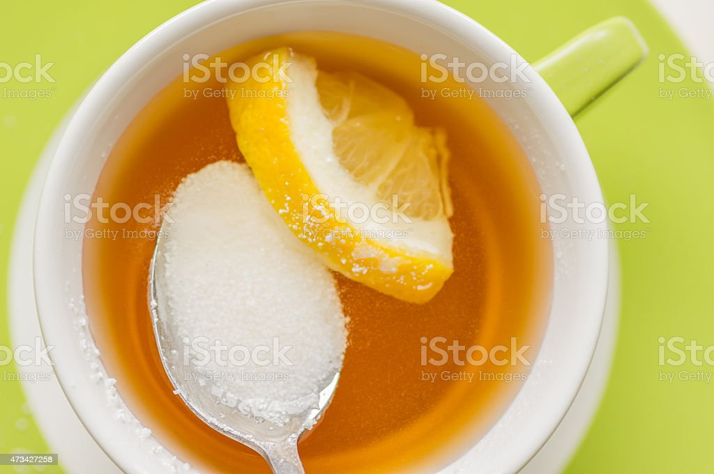 Spoon with a sugar substitute, sorbitol in tea stock photo