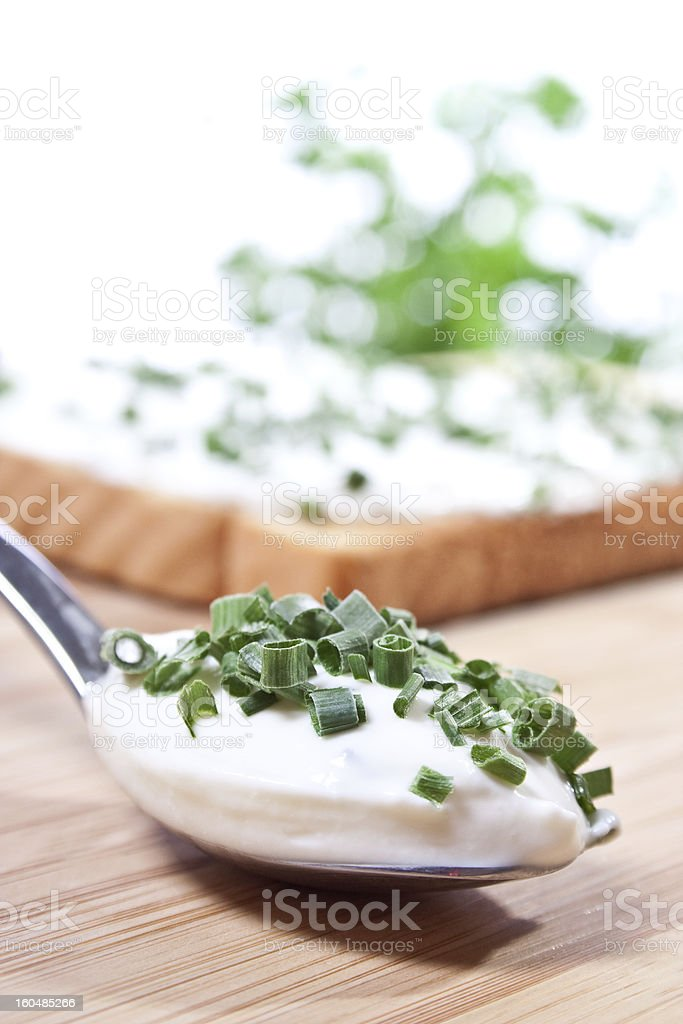 spoon with cottage cheese and chive royalty-free stock photo