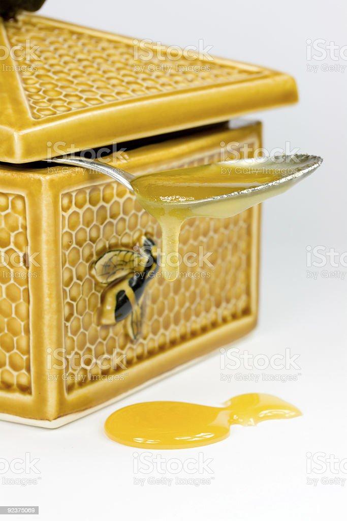 Spoon with honey royalty-free stock photo