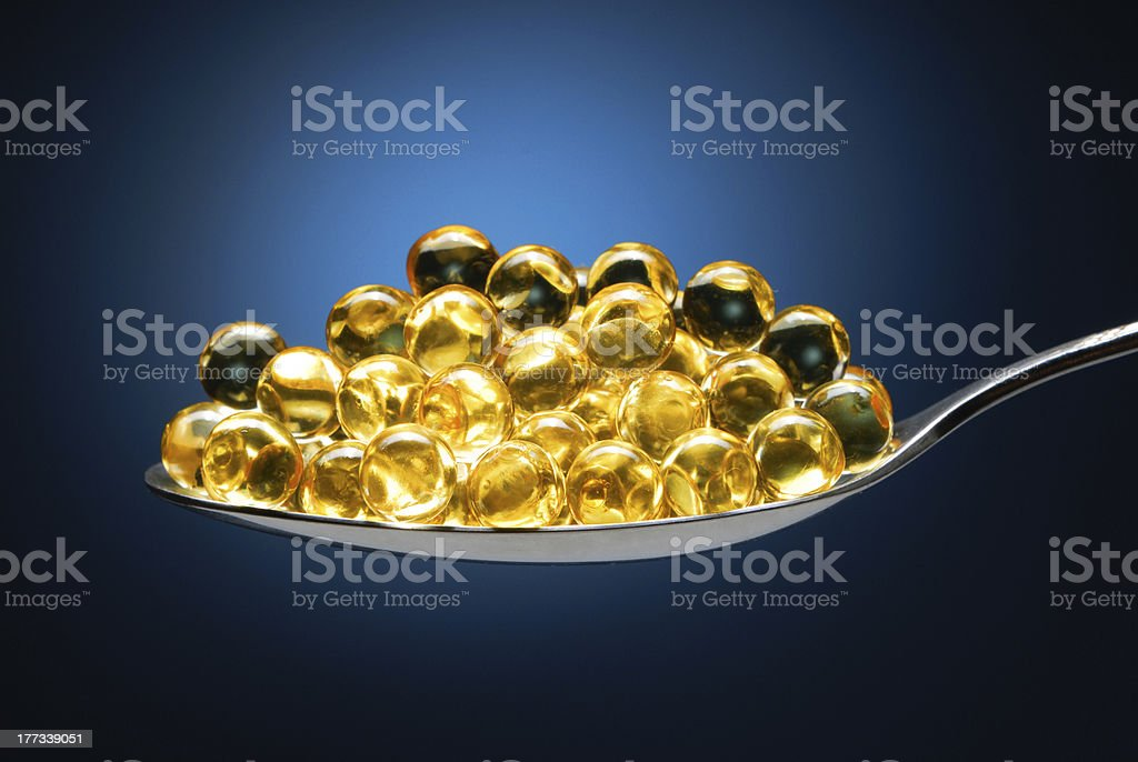 Spoon with pills royalty-free stock photo