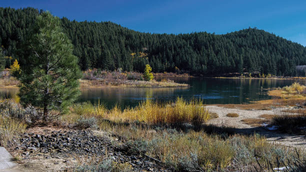 Spooner Lake in the Autumn with yellow leaves stock photo