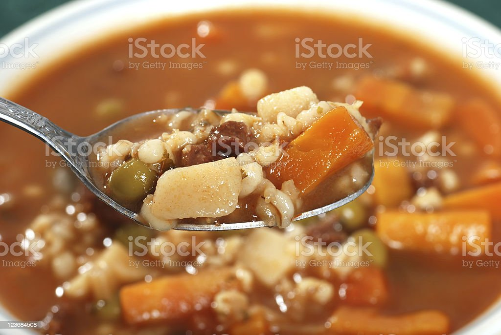 spoonful of beef barley soup stock photo