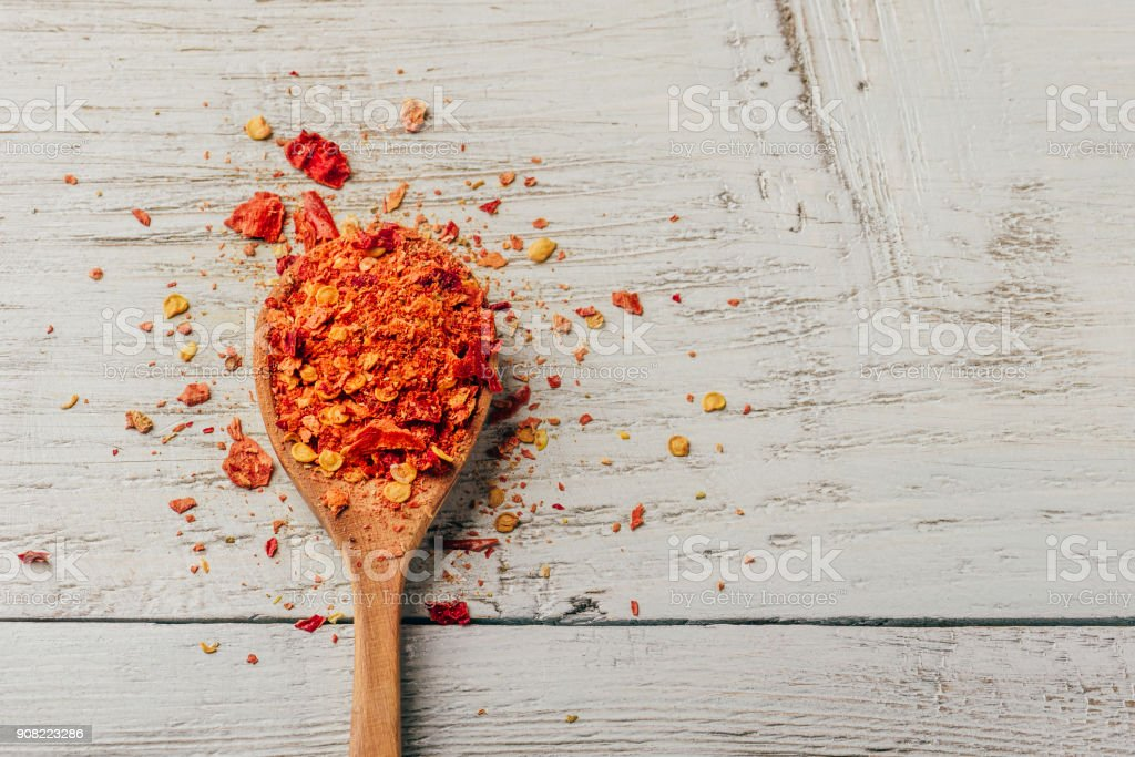 Spoonful of crushed chili pepper stock photo