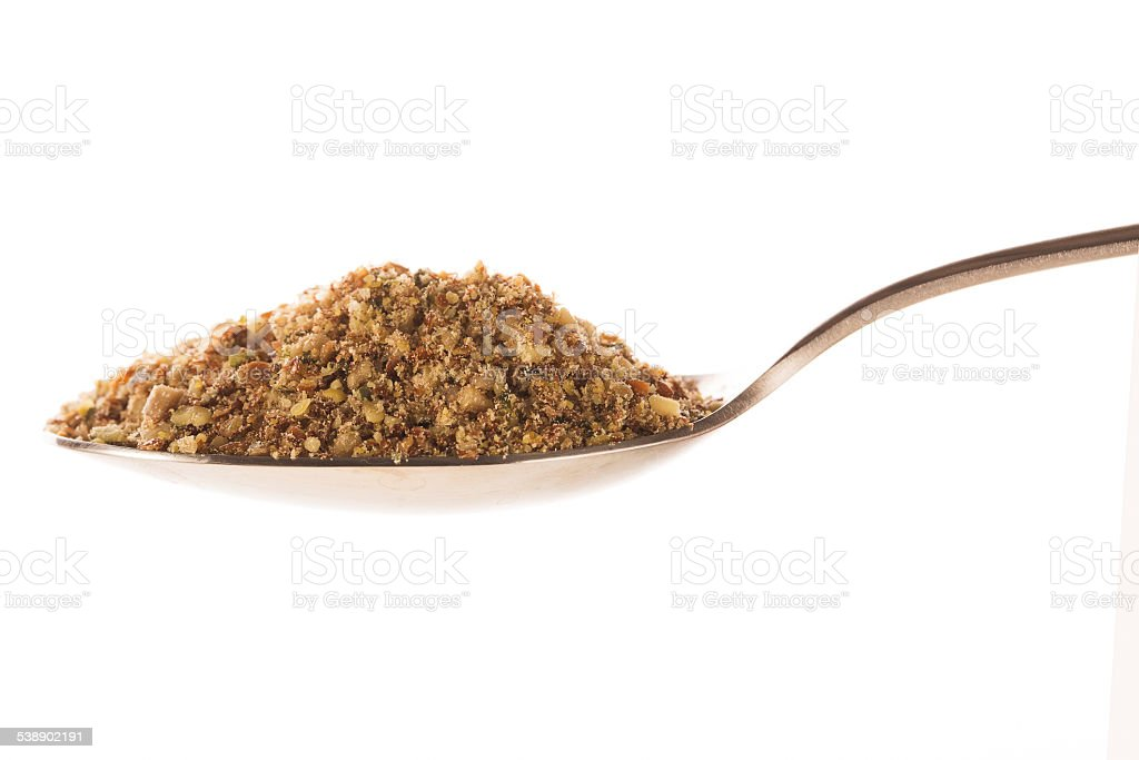 Spoonful of Ground Nut Mix stock photo