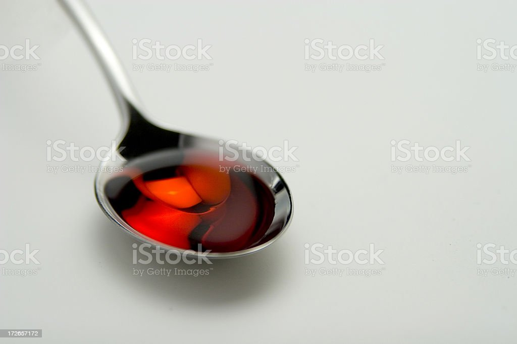 Spoonful of medicine royalty-free stock photo