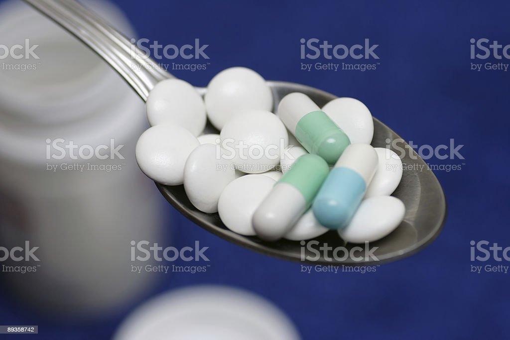 Cucchiaino di cibo di pillole#2 foto stock royalty-free