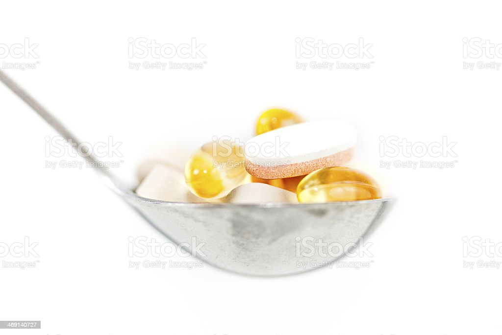 Spoonful of supplements royalty-free stock photo