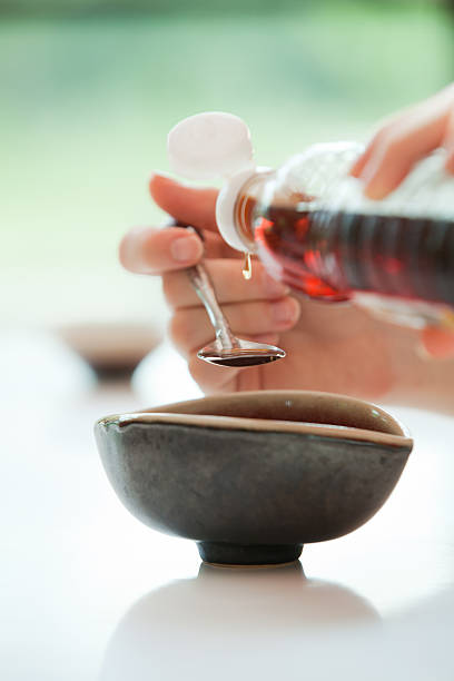 Spooning Fish Sauce into Bowl. Yum Khai Dao, stock photo